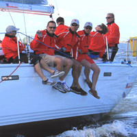 Sailing a regatta. A sailing event by Sail as a Team.